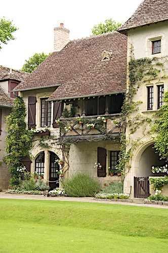 Parc Floral in Apremont-sur-Allier, Centre, France--In my vivid imagination, I see this as a multi-family dwelling and I'd like to occupy only the portion with the porch. What a charming French Country cottage it could make...(slj)