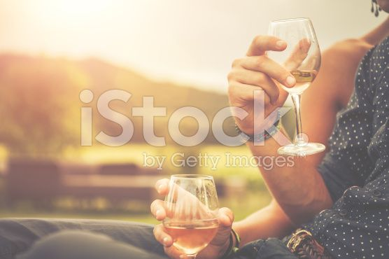 Couple drinking wine in cheerful moment royalty-free stock photo