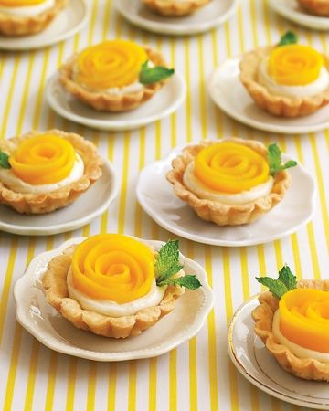 "Mango Rosette Tartlet. ・・・If love is like a rose, then these mango tartlets resembling the romantic blooms are truly the food of love -- minus the thorns. They're a diminutive treat to make for a light and fragrant dessert for a bridal shower, thanks to the airy pate-brisee crust and a vanilla-infused filling of creme fraiche. Arrange strips of fruit to form ""petals"" and garnish with a mint leaf."