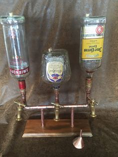 Free domestic shipping on the first liquor dispenser to sell from my store!! This is a unique triple liquor dispenser hand made of soldered
