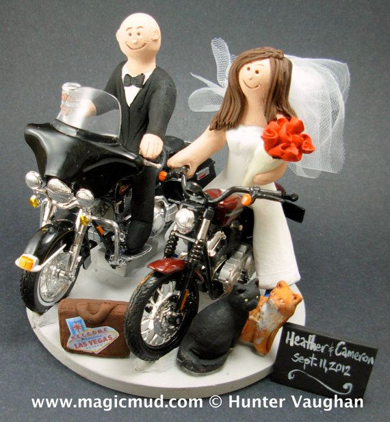 Motorcycle Bride Wedding Cake Topper  Custom Made to your specifications. Made just for your wedding day! Both the bride and groom are riding their own harley motorcycles!!    any style of motorcycle can be incorporated,,,a dirt bike, road bike, sport bike, Honda, Suzuki,Yamaha, Kawasaki  #magicmud, $235   1800 231 9814  www.magicmud.com