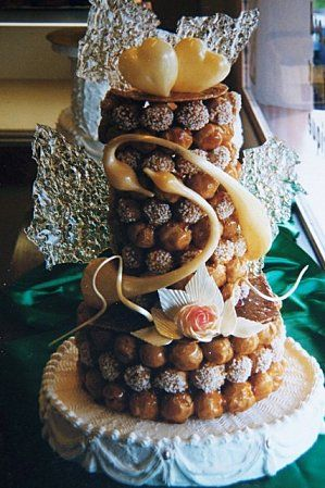 Wedding Cake alternative idea: Croquembouche. It's what the French do.