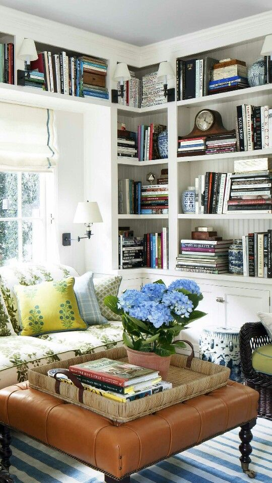 Built-in bookshelves and cosy seating area.