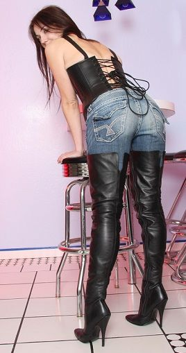 Babe displays her leather otk stiletto boots in a sexy pose.