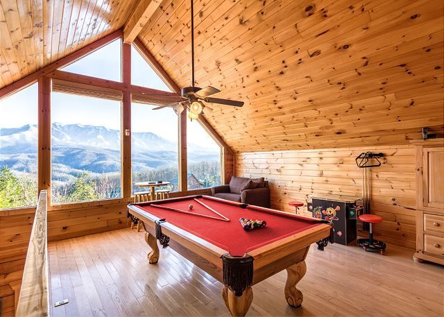 Gatlinburg Summit Views also offers you and your guests a full recreation loft area with floor to ceiling view windows and is action packed with a full size pool table and 60+ game multi-cade arcade system, and for your comfort, this area offers a pull out twin love seat for simply relaxing and taking in the views from your mountain top retreat.