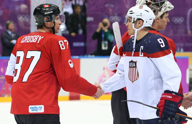 Zach Parise of the USA shakes hands with Sidney Crosby of Canada after the men's hockey semifinal at the Sochi 2014 Winter Olympic Games, Feb. 21, 2014. Photo by Jean Levac/Postmedia News