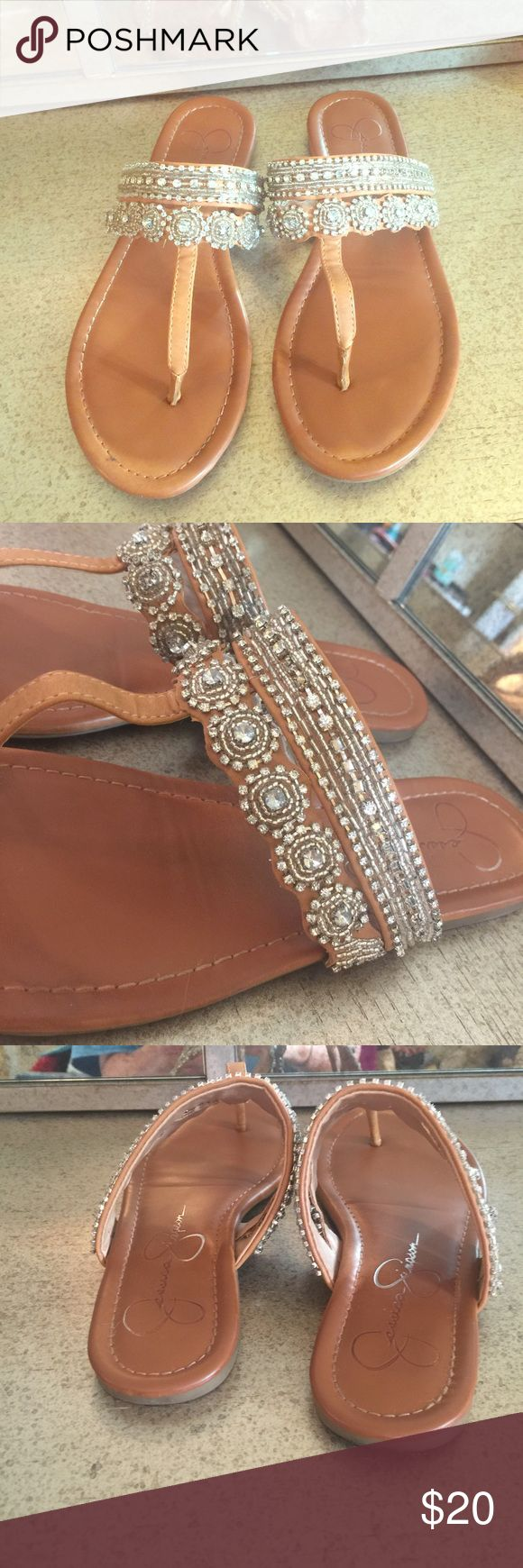 Jessica Simpson sandals Super cute Jessica Simpson sandals. Brown with silver accents. Some of the stones are missing (see pics) but otherwise good condition. Jessica Simpson Shoes Sandals