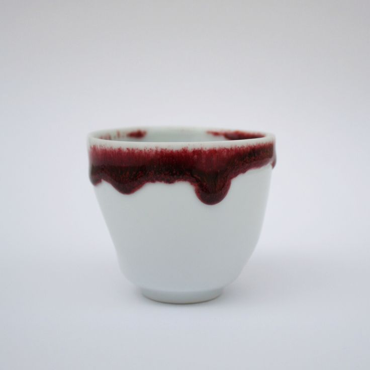 Thrown cup with oxblood glaze.