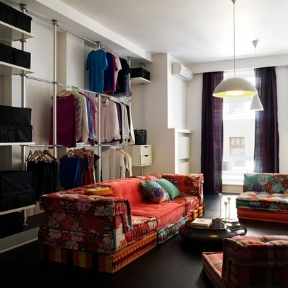 tiny flat solutions. love the use of vertical space.. and all the closet space.. I would probably cover it w/ a nice drape ...