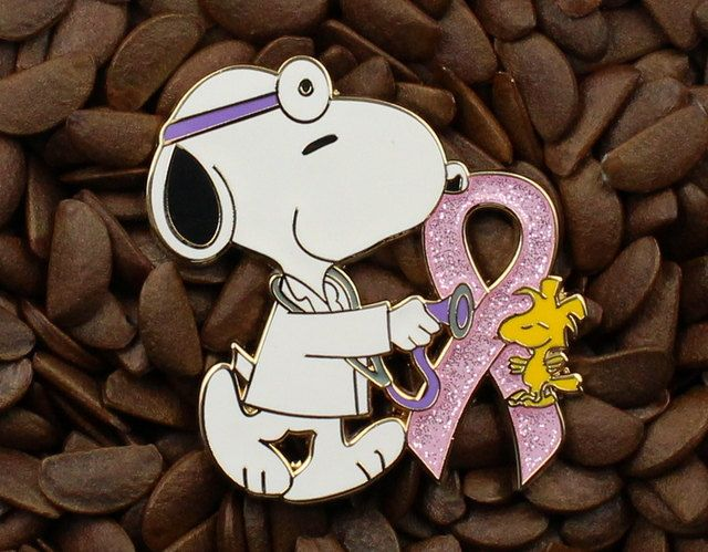 Snoopy doctor and Woodstock with breast cancer ribbon.