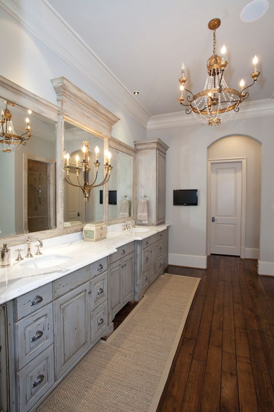 wood floors antique chandelier gray cabinets beautiful mirror