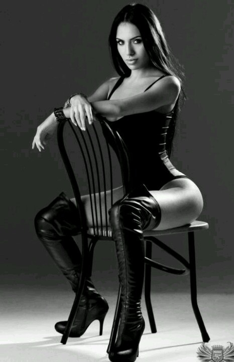 Leather. Sexy. Posed on a chair. Strong.