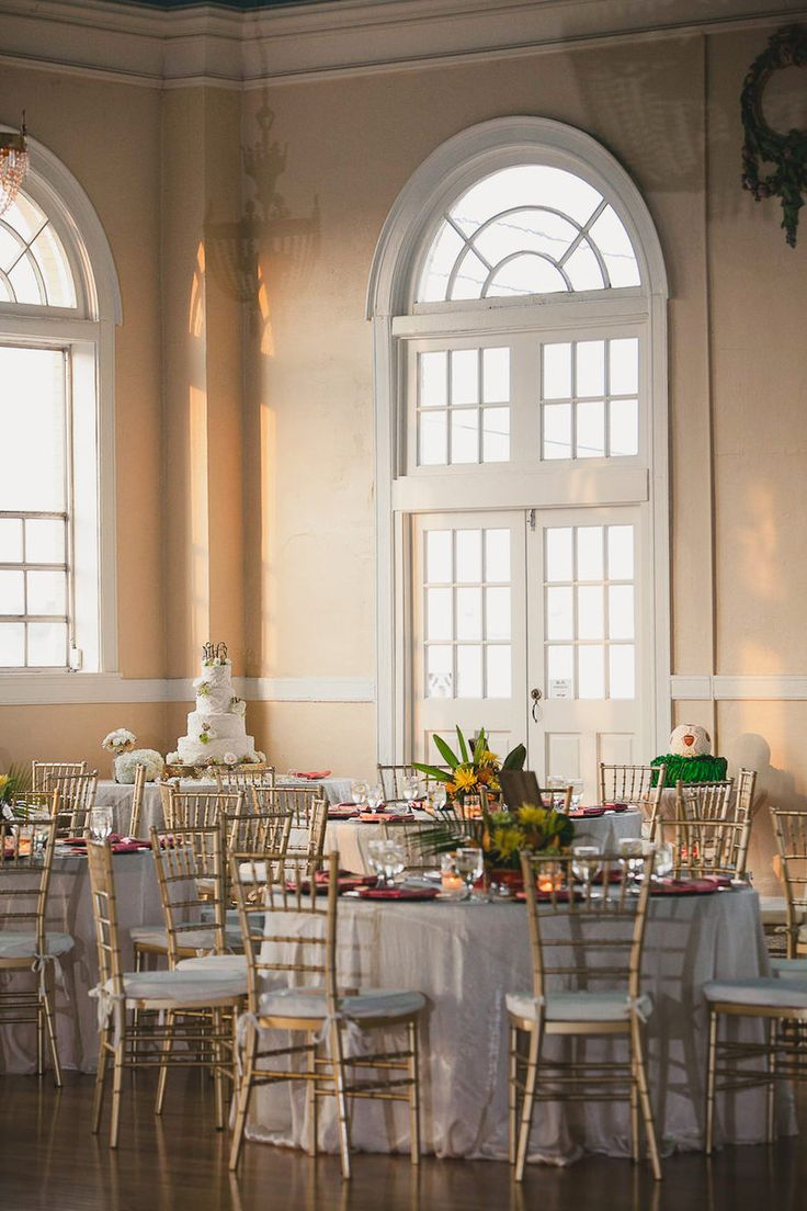 Indoor Ybor City Wedding Reception Decor With White Linens And Gold Chiavari Chairs