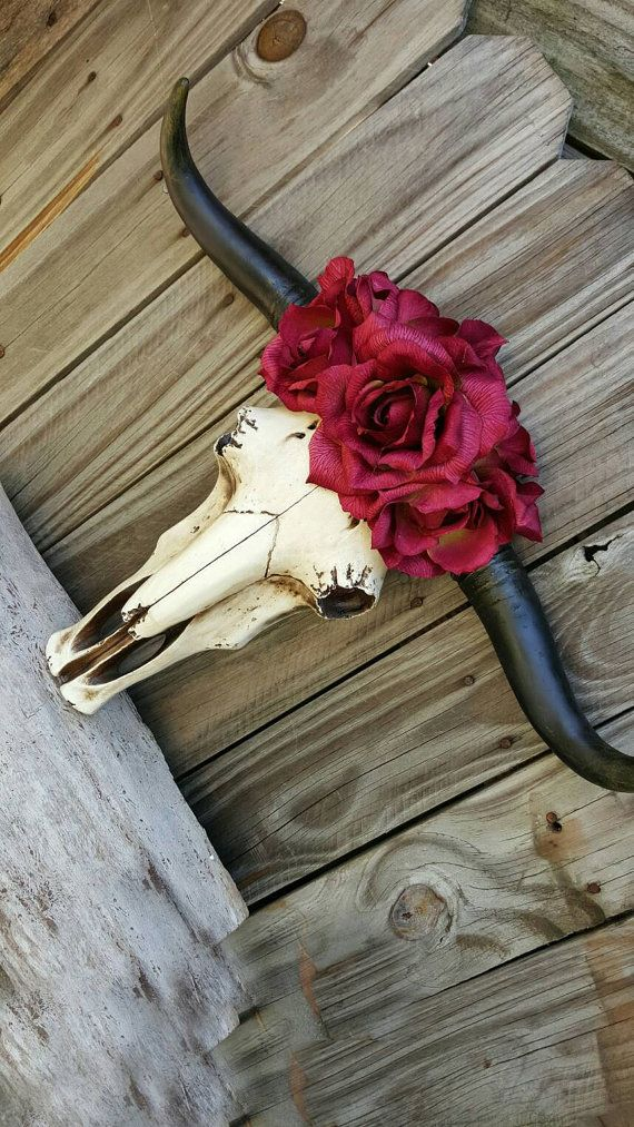Cow skull with horns, longhorn, decorated skull, gypsy, faux taxidermy skull, floral crown skull, resin, roses, western gift........................................This is the PERFECT option to have that beautiful soft touch of country in your home! Here is the best part - the back of the skull is completely FLAT with a wall hanger! BOOM done - all you need is a nail!  This is a GORGEOUSLY detailed resin skull that is topped with lush ombre red roses. There is NO bad angle to this beauty…
