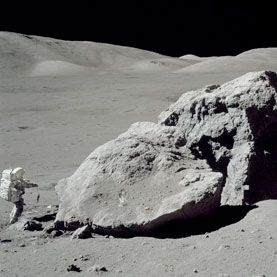 MOON SHOTS: Astronaut Harrison Schmitt standing next to boulder during third EVA of Apollo 17, NASA's final manned mission to the moon.  Image: NASA