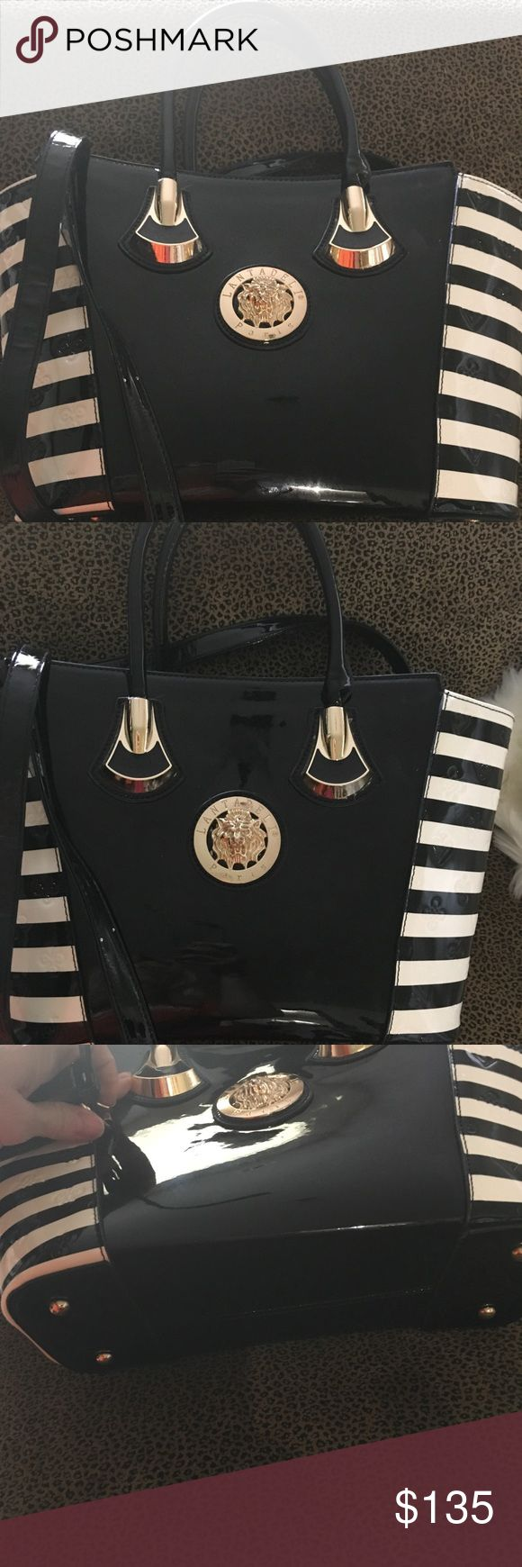 Lantadeli Paris black and cream handbag Lantadeli Paris black and cream striped, stamped and solid patent tote with gold hardware short and long shoulder straps and black interior. I purchased this bag in Canary Islands, Spain at a Boutique. Lantadeli Paris Bags Satchels