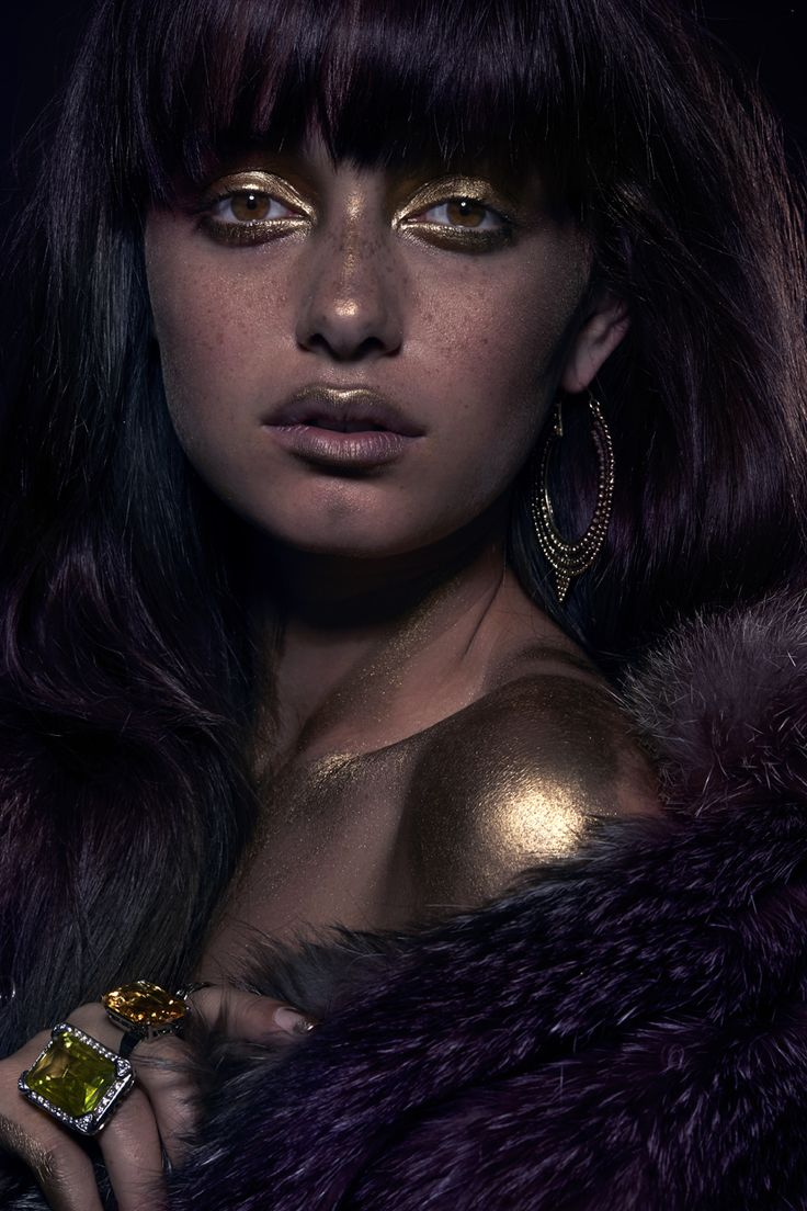 Jetsetbohemian fur gilet and tribal earrings. Kagi rings.