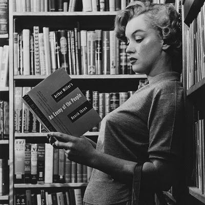 there are a fair few pics of Marilyn reading. she was an avid reader and owned an extensive library of books.