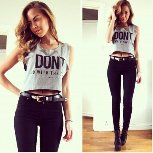 High wasted black jeans and cropped top.