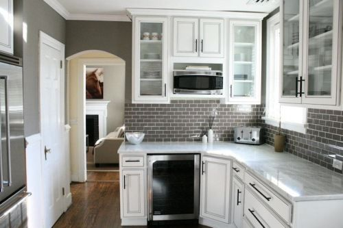 Stunning White U0026 Gray Kitchen Design With Warm Gray Walls Paint Color, Gray  Glass Subway Tiles Backsplash, Creamy White Kitchen Cabinets With Marble ...