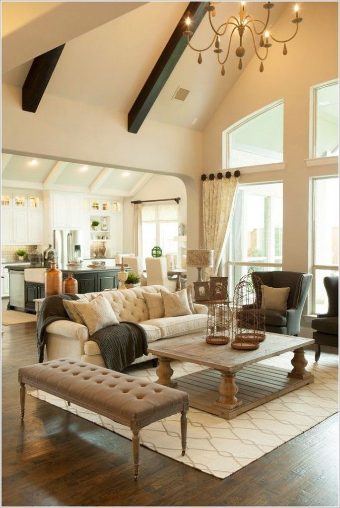 cathedral ceiling living room with chandelier Love