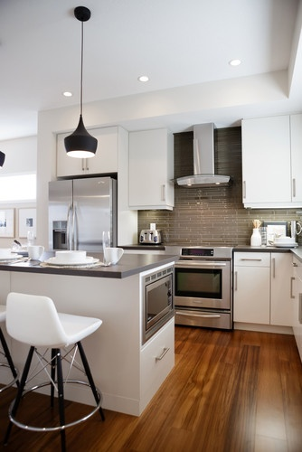 I Really Like The Wood Floor Simple White Cabinets Stainless Appliances Dark Backsplash And Counter Combo
