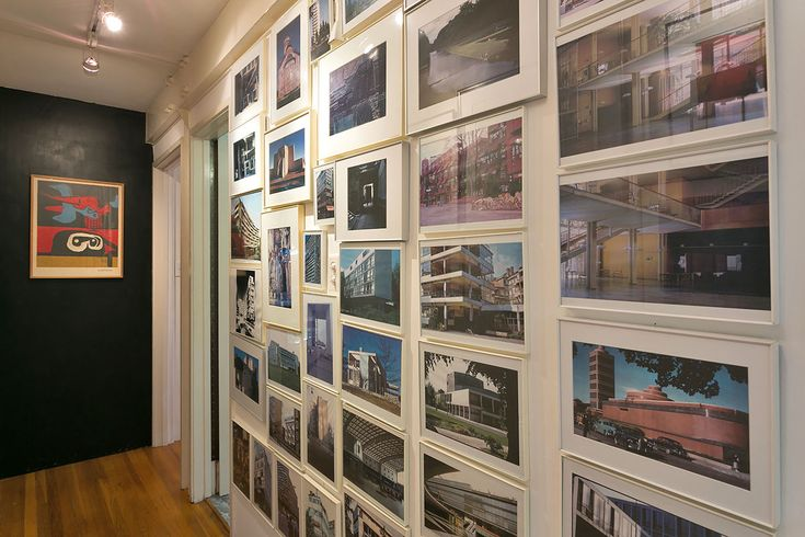 An architectural photo montage adorns the wall.