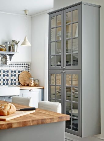 "This idea seen in various sizes of modules in the new 2014 IKEA catalog. ""Upper"" wall cabinets hung in grids on available/dead wall at whatever handy height. HAKURUM wall cabinets."