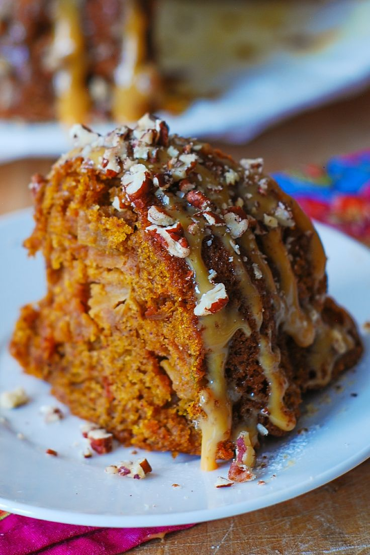 Apple pumpkin bundt cake with caramel sauce and pecans. It's like having Autumn on your plate! It will make a great addition to your dessert menu for Thanksgiving! JuliasAlbum.com Thanksgiving dessert recipes