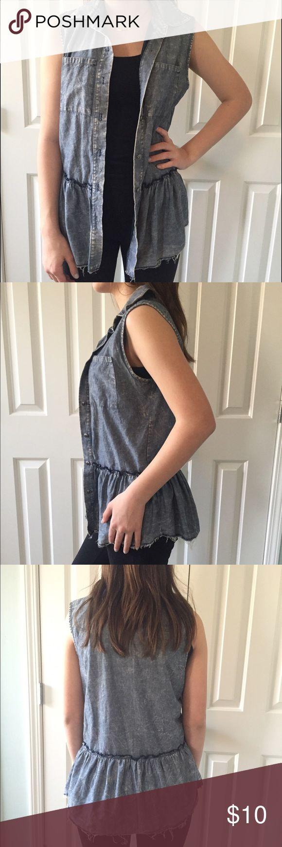 Socialite sleeveless ruffle denim shirt Size XS sleeveless denim button up shirt with flirty ruffle bottom.  From Nordstrom worn once.  100% cotton.  Very soft. socialite Tops Button Down Shirts