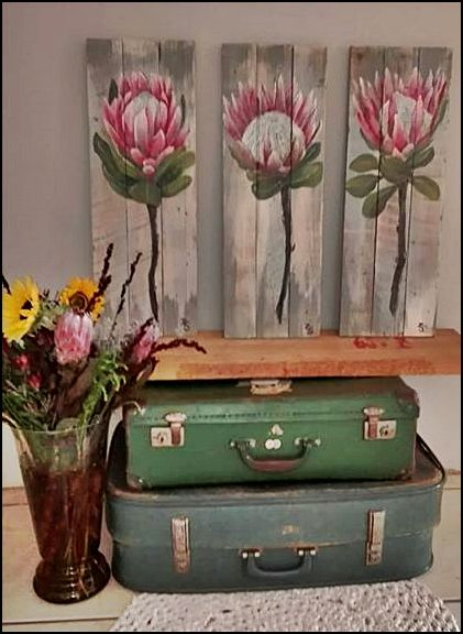 Recycle or re-use. Simple and easy. Stack a few old suitcases, pot of flowers and a wooden canvas (up-cycled pallet wood) with 3 stunning proteas. Cheers up a small space, entrance hall or corner in your cozy bedroom!
