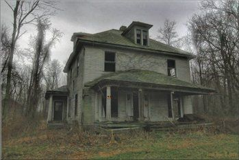"""As a fan of ghost stories, I really appreciate Linda's photos of haunted houses. She found this abandoned house outside of Jamestown, PA.  """"My camera quit working after a few minutes, making buzzing sounds and locking up,"""" she wrote. """"I went outside and the sounds stopped. So I shot a few pics from the doorway! It was quite creepy."""""""