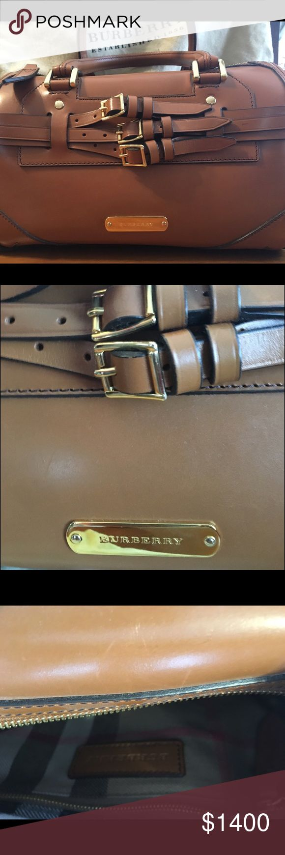 Burberry leather buckle bag Pristine condition Burberry leather bag. 3 buckles enhance the look of this beautiful bag. Interior plaid lining with one zipper pocket and 2 pouch pockets. Includes removable strap and dust bag. Burberry Bags Satchels