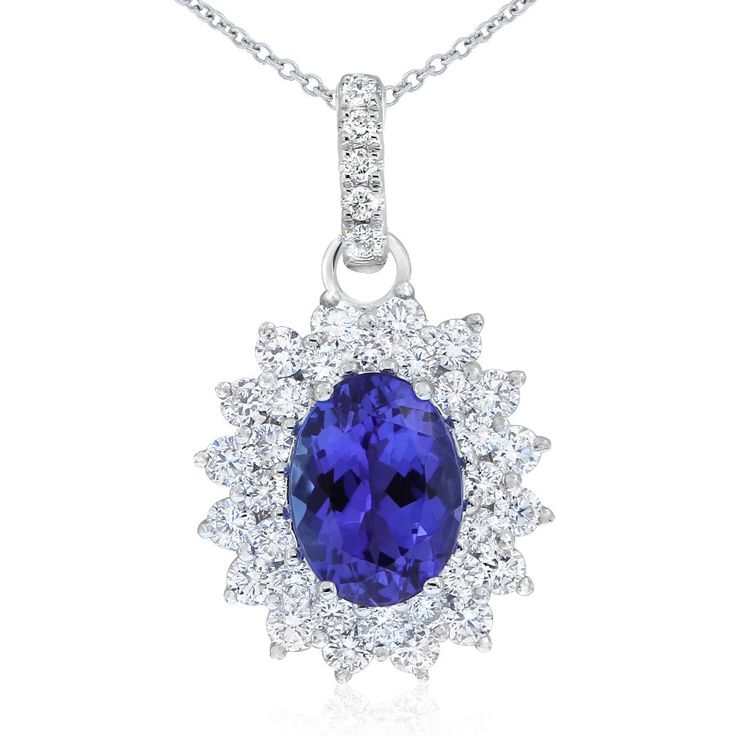 Rare and beautiful. Kilimanjaro tanzanite and diamond cluster style pendant. This oval tanzanite is a deep purple-blue colour. Crafted in 18ct white gold. The 18ct gold chain is adjustable from 42 - 45cm long.