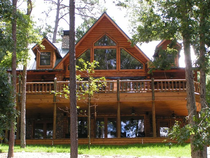 I 39 ve always liked the idea of a log home with a wrap for Log cabin homes with wrap around porch