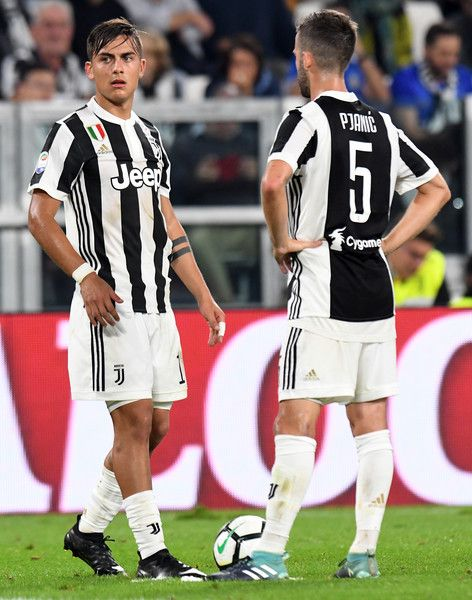 Paulo Exequiel Dybala and Miralem Pjanic of Juventus during the Serie A match between Juventus and Torino FC on September 23, 2017 in Turin, Italy.