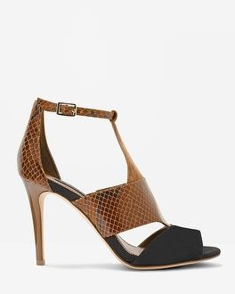 These strappy heels in color block snake-print take it up a notch for a feminine, flirty look with slim ankle pants, jeans and anything suede. Suede and leather tri-color shootie  Approx. 3.75  Suede, leather, and manmade materials; synthetic sole Imported