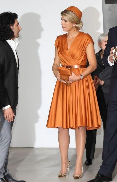 Queen Maxima had an amazing wardrobe for her royal tour - click to see more outfits like this striking all-orange ensemble