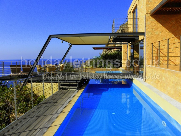 4 bedroom villa in Livadia to rent from £1417 pw, with a private pool and a tennis court. Also with jacuzzi, solarium, balcony/terrace, air con, TV and DVD.