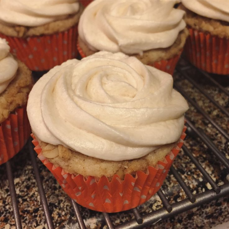 French toast cupcakes topped with a rolled oat streusel and maple buttercream.