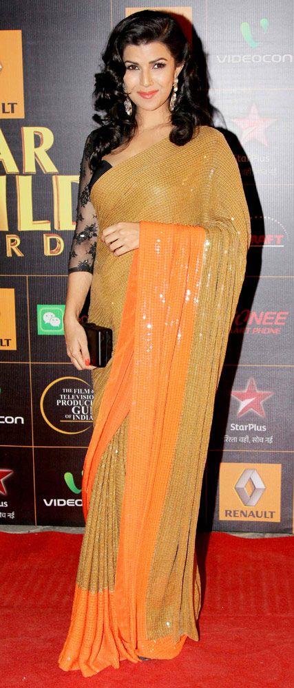 Nimrat Kaur in orange sequined sari at the Star Guild Awards 2014.