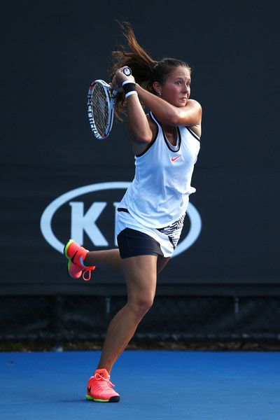 Daria Kasatkina Photos Photos - Daria Kasatkina of Russia plays a backhand in her first round match against Shuai Peng of China on day one of the 2017 Australian Open at Melbourne Park on January 16, 2017 in Melbourne, Australia. - 2017 Australian Open - Day 1