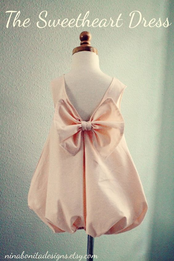 darling dress with bow on back and on front for little girl.  (pattern). Gotta have Nana make this for my girl!: