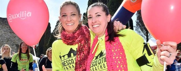 Rebekah Gregory, left, and Melissa Schulz pose near the finish line of the UNESCO Cities Marathon, March 28, 2015. (Courtesy of UNESCO/Uxilia)