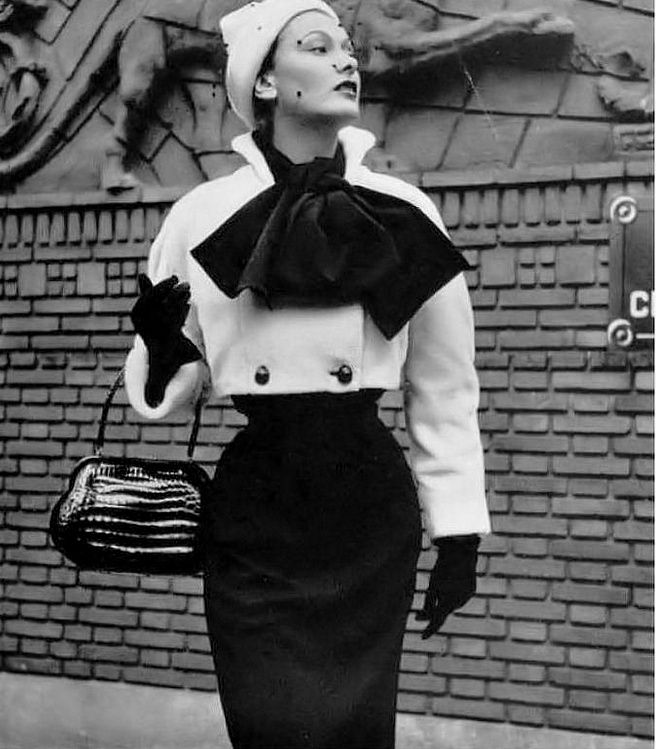 1950 Jeanne Lanvin creates a charming contrast of black and white in this beautiful ensemble consisting of a white plush bolero and a jersey dress
