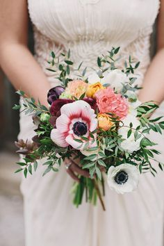 anemone bouquets - photo by Clean Plate Pictures http://ruffledblog.com/stylish-green-building-wedding