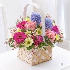 Beautiful Spring #Flowers Arranged by Carolanne Flowers in #MiltonKeynes.  Spring Basket  A colourful arrangement of flowers including:  chrysanthemum, germini, carnations,  freesia, and hyacinths