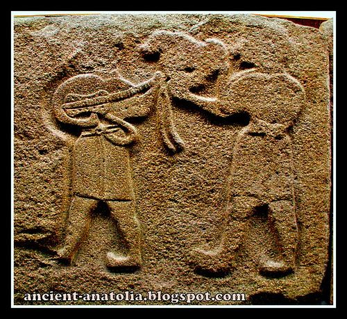 Hittite bas-relief (13th century BCE) found at Alacahöyük,Turkey. The slab shows a figure holding an animal and another one who plays a stringed instrument which seems a lute or a guitar. So this is the oldest known relief of a guitar so far. I wonder what the minstrel was playing: maybe an hittite version of Blowing in the Wind.
