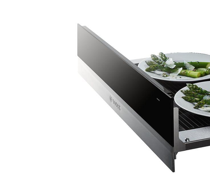 Bosch nieuwe 8 Serie: De nieuwe warmhoudlades kunnen meer dan alleen maar gerechten en borden warmhouden. Ze zijn ook perfect voor het langzaam garen van vlees, het ontdooien van diepvriesproducten, het smelten van chocolade, het drogen van fruit en het rijzen van deeg. Wilt u extra opbergruimte? Kies dan voor onze accessoirelades met veel ruimte voor bakblikken en kookgerei.
