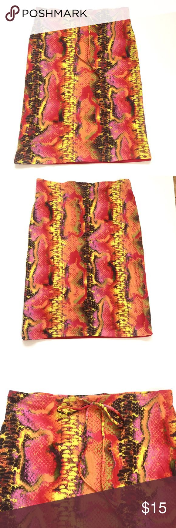 """To The Max Sleek Pencil Skirt -Size small -Colorful snake skin print -Elastic waist, pull on style -Lined -Matching tie at waist -Waist: 15"""" -Length: 23"""" -No rips, tears, stains or holes -Smoke free household To the Max Skirts Pencil"""